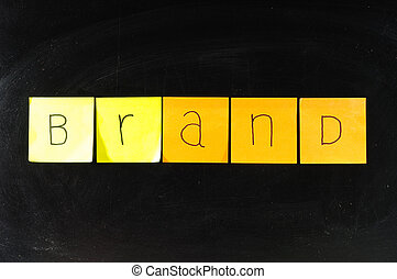 Concept of brand paper on blackboard
