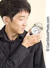 concept of businessman with a clock on the shoulder