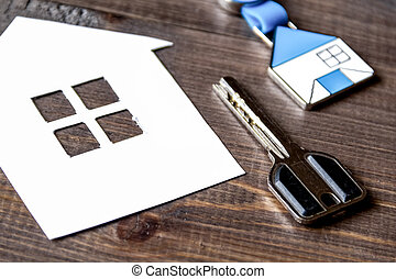 concept of buying house on wooden background close up