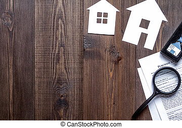 concept of buying house on wooden background top view