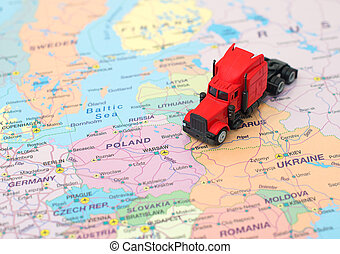 Concept of cargo transportation. The truck is on the map in Belarus.