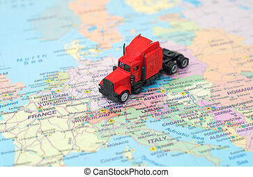 Concept of cargo transportation. The truck is on the map in Germany.
