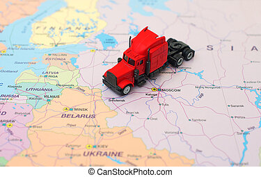 Concept of cargo transportation. The truck is on the map in Russia.