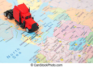 Concept of cargo transportation. The truck is on the map in Sweden.