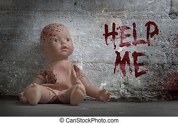 Concept of child abuse - Bloody doll, vintage