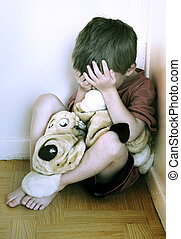 Concept of Child Abuse. - Lonely boy being punished in the...