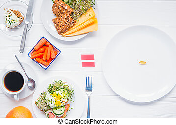 Concept of choice and equality - healthy food or medical pills, top view on the white wooden table. Choice between natural and synthetic way of health care. Alternative medicine. Dietary supplement.