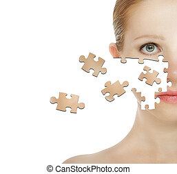 concept of cosmetic effects, treatment and skin care. face of young woman of the particle puzzle