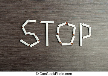 "concept of dangers of smoking. word ""stop"" of cigarettes - ..."