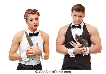Cute girl with knife and brutal man holding kitten - Concept...
