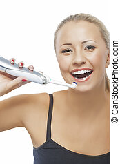 Concept of Dental Health: Blond Caucasian Woman Brushing Her Tee