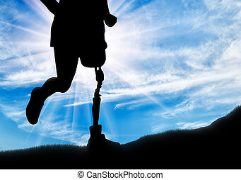Man with prosthetic leg running up the hill