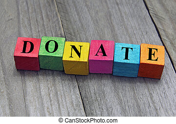 concept of donation word on wooden cubes