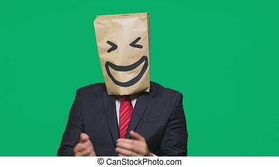 concept of emotions, gestures. a man with paper bags on his head, with a painted emoticon, smile, joy