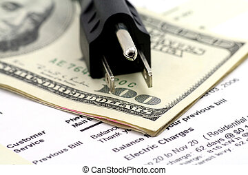 concept of expensive energy bill - power cord and us dollar,...