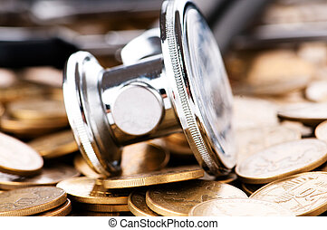 Concept of expensive healthcare with coins and stethoscope