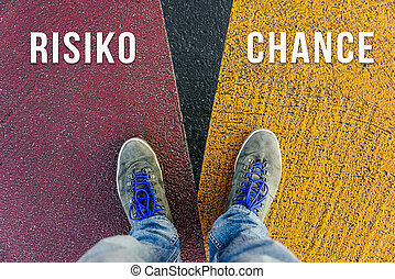 Concept of facing a crucial decision symbolized by risiko and chance in german meaning risk and chance written on different colored pathways