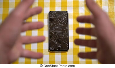Concept of falling smart phone with broken screen. Top view...