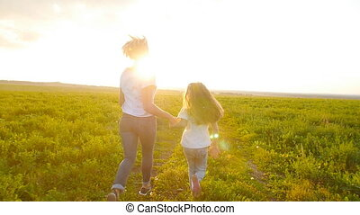 Concept of family and motherhood. Happy Mother and child run...