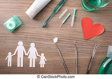 Concept of family dental insurance on table with representative elements