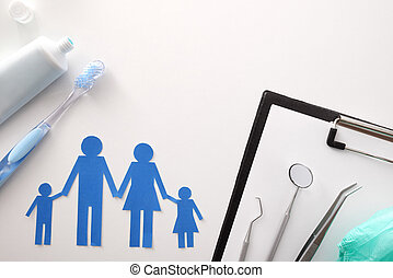 Concept of family dental insurance on white table top