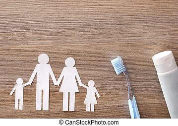 Concept of family dental insurance on wood table