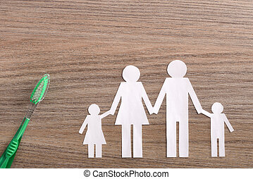 Concept of family dental insurance on wood table top