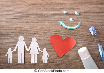 Concept of family dental insurance with representative elements on table