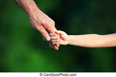 concept of family. Hand the child's in hand  father