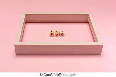 concept of FAQ word on wooden cubes