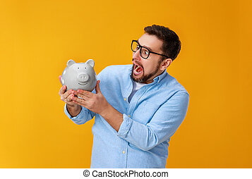 concept of Finance and business.  man with  piggy Bank on  yellow background color