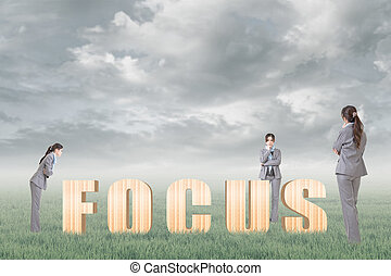 Concept of focus, point, center etc with 3d wooden text and...