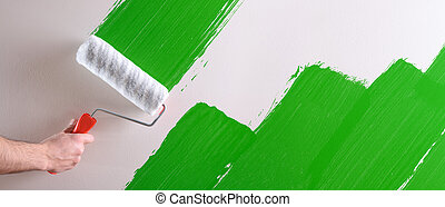 Concept of hand painting green sample on wall