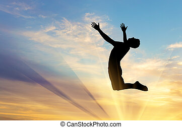 Silhouette happy man jumping