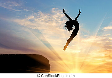 Silhouette of happy woman jumping
