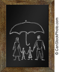 Concept of happy family in safety. Chalk drawing on the blackboa