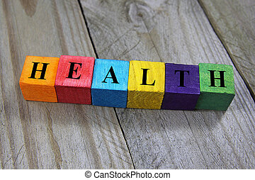 concept of health word on wooden colorful cubes