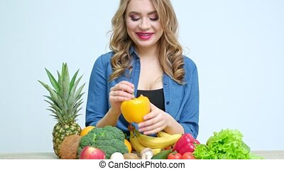 Concept of healthy eating, woman in the kitchen with a ...