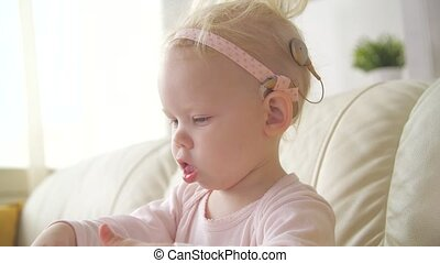 concept of hearing impairment and their treatment. Child with a hearing aid