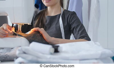 Concept of hobby and small business. Woman tailor working on...