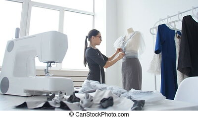 Concept of hobby and small business. Young female seamstress...