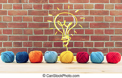 Concept of idea and innovation with wool ball that shapes a lightbulb