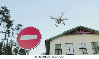 Concept of invasion of private property. Drone is shooting a...
