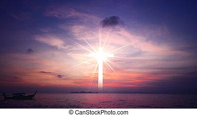Concept of Jesus Christ: white cross on sunset sky background
