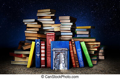 Concept of knowledge that is not used. Stack of books with door on a gloomy background. Concept of education.