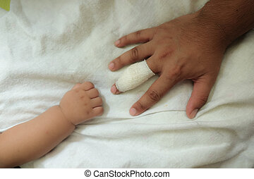 concept of love and family. injury hand finger take care by baby