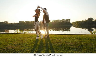 Concept of love and relationships. Young couple dancing at...