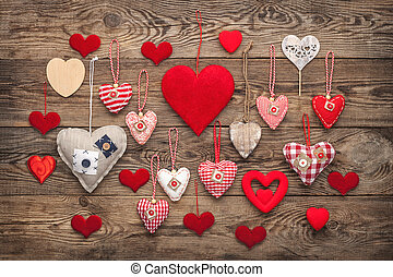 Concept of love. Heart from a fabric on a background of the old board