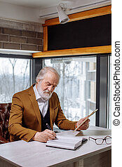 concept of man in old age is writing a book