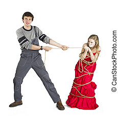 Concept of mesalliance and unequal match. Lady in red dress...